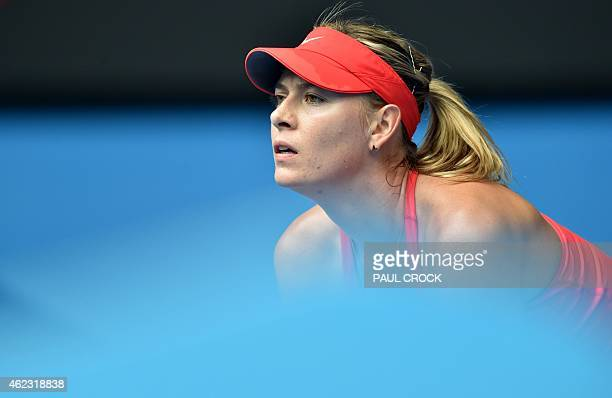 Russia's Maria Sharapova waits to receive serve during her women's singles match against Canada's Eugenie Bouchard on day nine of the 2015 Australian...