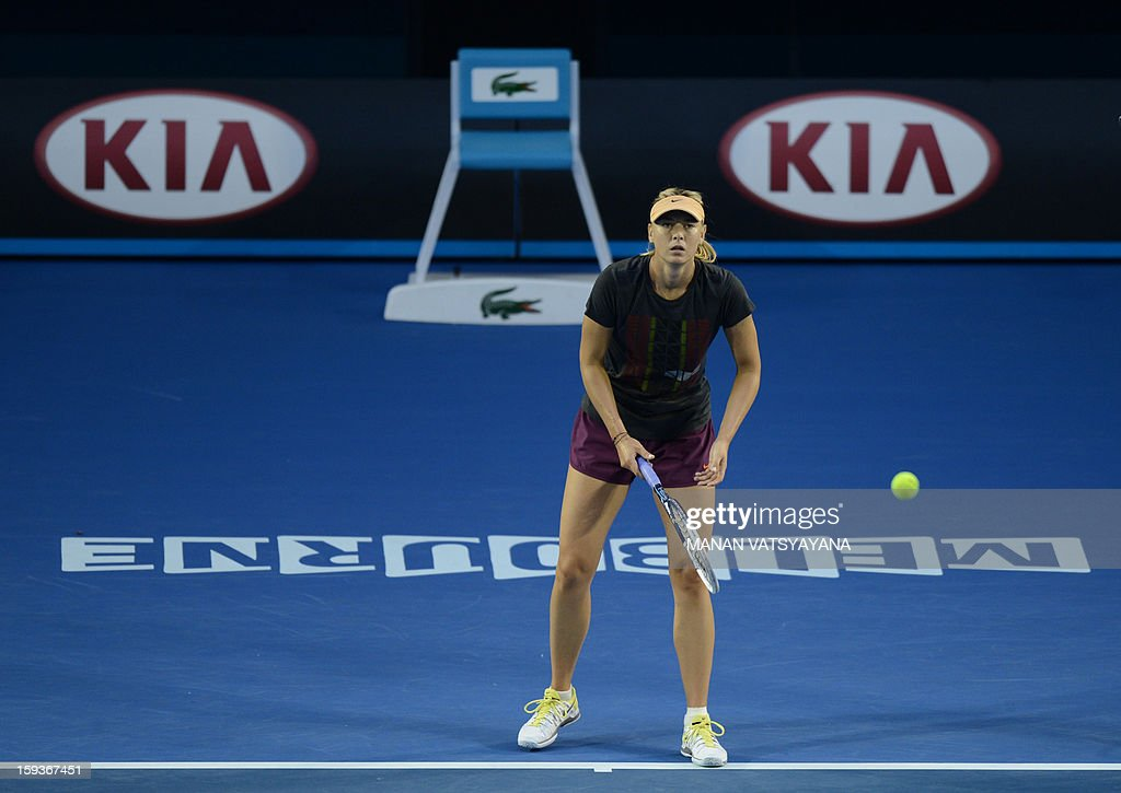 Russia's Maria Sharapova watches the ball as she plays a return during a practice session ahead of the 2013 Australian Open tennis tournament on January 13, 2013. AFP PHOTO/MANAN VATSYAYANA IMAGE STRICTLY RESTRICTED TO EDITORIAL USE - STRICTLY NO COMMERCIAL USE