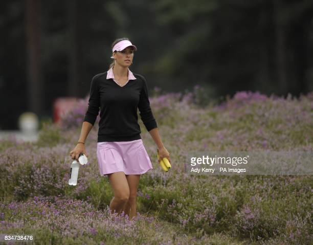 Russia's Maria Verchenova walks through the heather on the 11th hole carrying water and bananas during the Ricoh Womens British Open at Sunningdale...