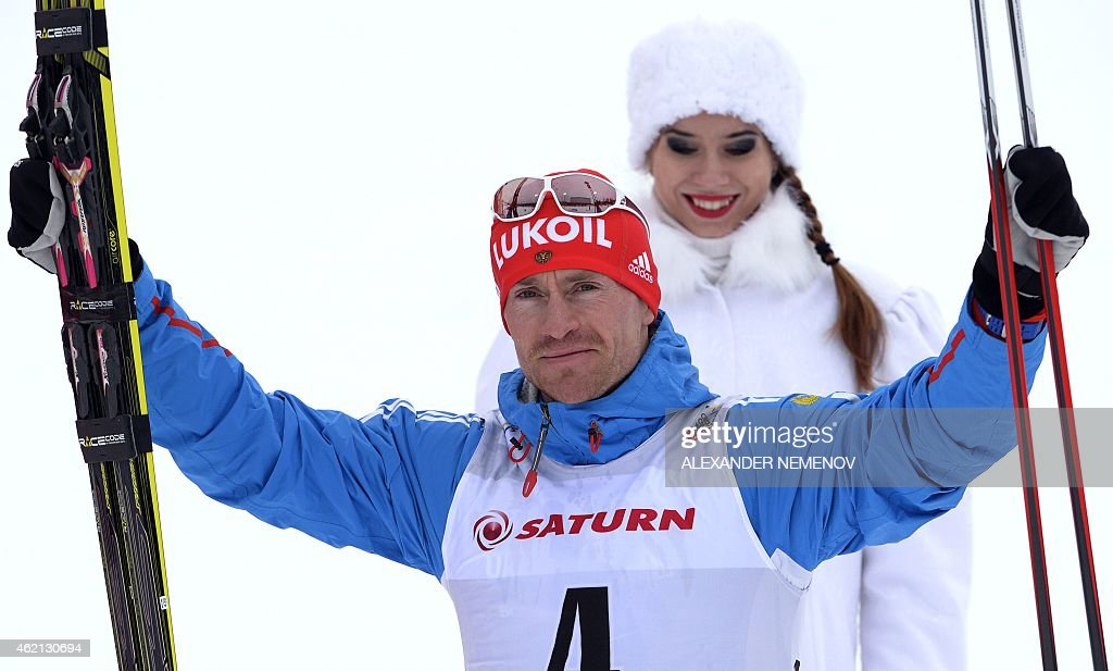 Russia's <a gi-track='captionPersonalityLinkClicked' href=/galleries/search?phrase=Maxim+Vylegzhanin&family=editorial&specificpeople=4779618 ng-click='$event.stopPropagation()'>Maxim Vylegzhanin</a> celebrates after winning the men's skiathlon 15 km classic + 15 km free race of the FIS Cross-country World Cup on January 25, 2015 in Rybinsk. Russia's <a gi-track='captionPersonalityLinkClicked' href=/galleries/search?phrase=Maxim+Vylegzhanin&family=editorial&specificpeople=4779618 ng-click='$event.stopPropagation()'>Maxim Vylegzhanin</a> won ahead of silver medalist Switzerland's Dario Cologna and bronze medalist Finland's Matti Heikkinen.
