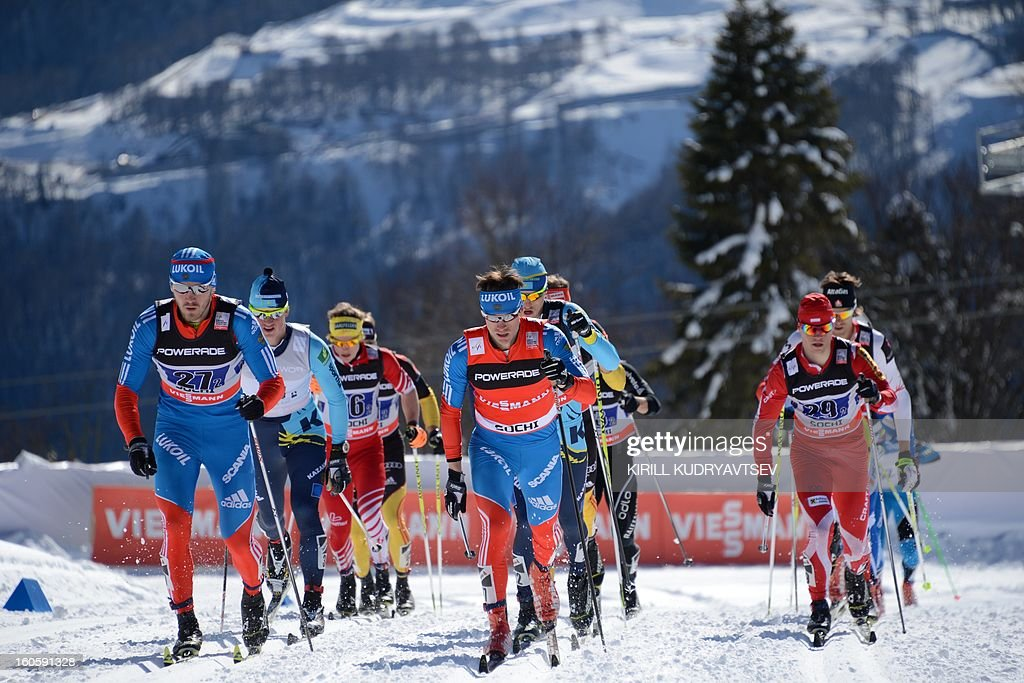 Russia's Maxim Vylegzhanin (front C) competes during 6 x 1,8 km Men's Classic Team Sprint of FIS Cross Country skiing World Cup at Laura Cross Country and Biathlon Center in Russian Black Sea resort of Sochi on February 3, 2013. Russia's Maxim Vylegzhanin and Dmitry Japarov took the first place ahead of Sweden's Teodor Peterson and Emil Joensson and Germany's Axel Teichmann and Tobias Angerer .