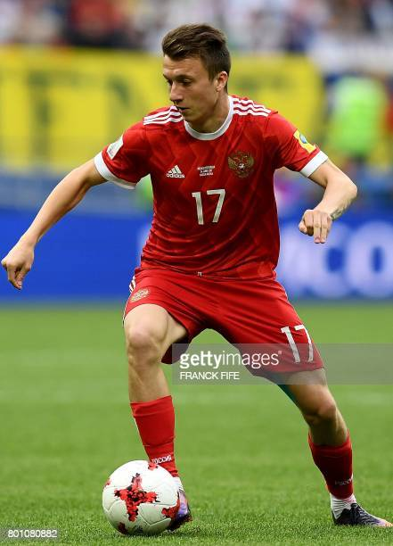 Russia's midfielder Aleksandr Golovin controls the ball during the 2017 Confederations Cup group A football match between Mexico and Russia at the...