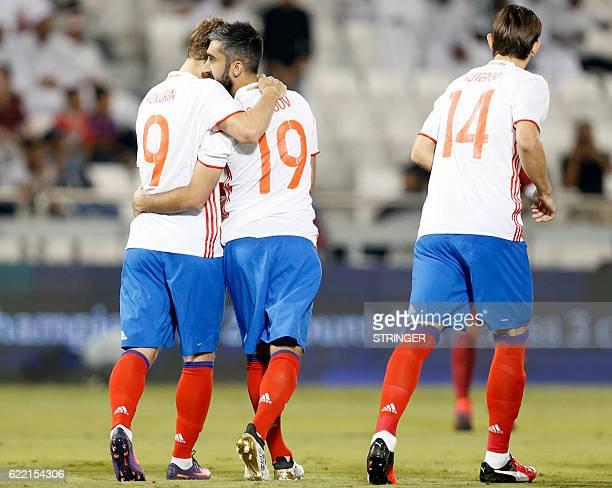 Russia's midfielder Aleksandr Samedov celebrates his goal with teammate Aleksandr Kokorin during the International friendly match between Qatar and...