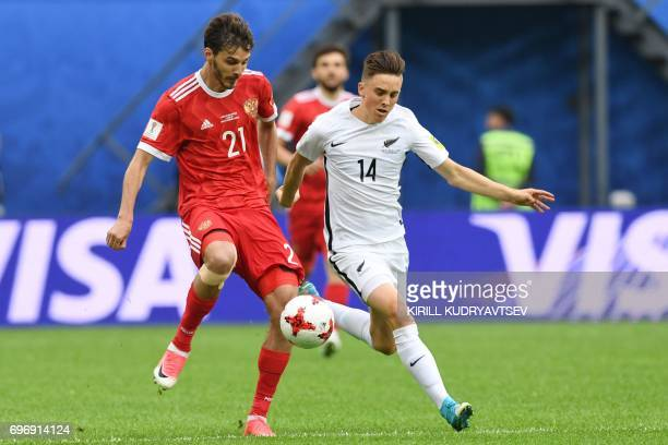 Russia's midfielder Alexander Erokhin vies for the ball against New Zealand's midfielder Ryan Thomas vduring the 2017 Confederations Cup group A...