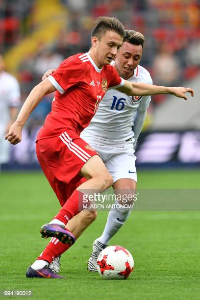 Russia's midfielder Alexander Golovin and Chile's defender Gonzalo Jara vie for the ball during a friendly football match between Russia and Chile at...