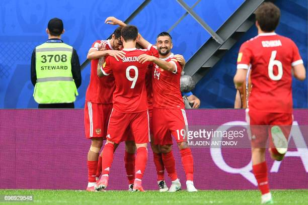 Russia's midfielder Alexander Samedov and team mates celebrate their team's first goal during the 2017 Confederations Cup group A football match...