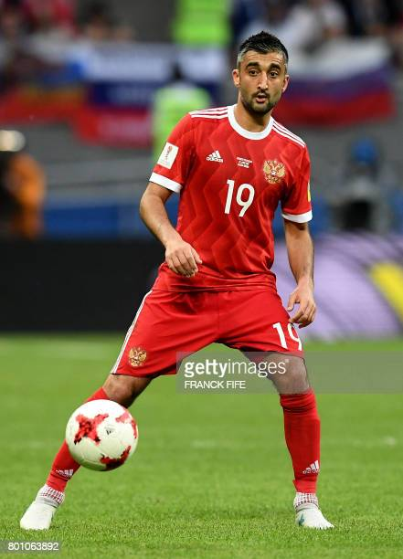 Russia's midfielder Alexander Samedov controls the ball during the 2017 Confederations Cup group A football match between Mexico and Russia at the...
