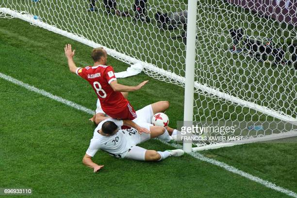 TOPSHOT Russia's midfielder Denis Glushakov scores the first goal of the match during the 2017 Confederations Cup group A football match between...