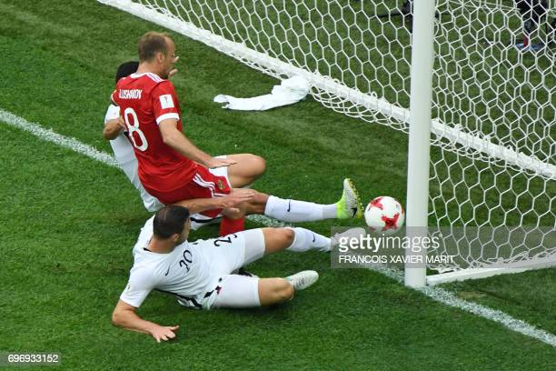 Russia's midfielder Denis Glushakov scores the first goal of the match during the 2017 Confederations Cup group A football match between Russia and...