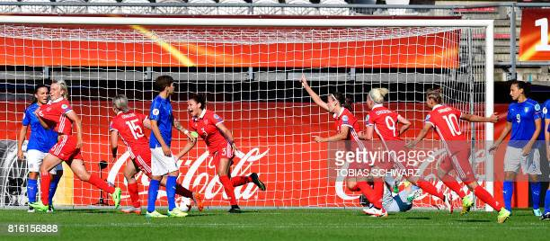 Russia's midfielder Elena Morozova celebrates with teammates after scoring during the UEFA Women's Euro 2017 football tournament match between Italy...