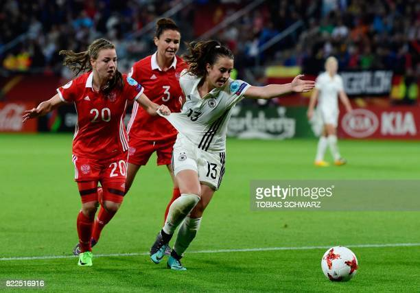 Russia's midfielder Margarita Chernomyrdina fouls Germany's midfielder Sara Daebritz during the UEFA Women's Euro 2017 football match between Russia...
