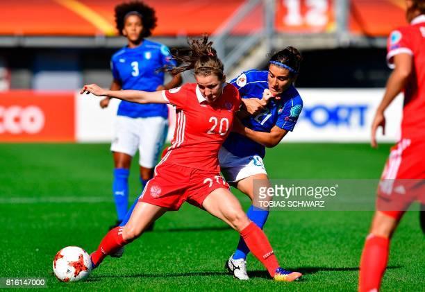 Russia's midfielder Margarita Chernomyrdina holds off Italy's midfielder Marta Carissimi during the UEFA Women's Euro 2017 football tournament match...