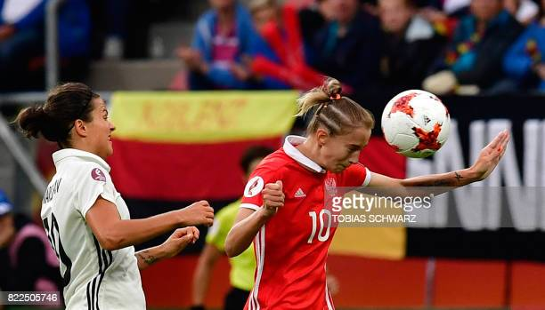 Russia's midfielder Nadezda Smirnova heads the ball next to Germany's midfielder Dzsenifer Marozsan during the UEFA Women's Euro 2017 football match...
