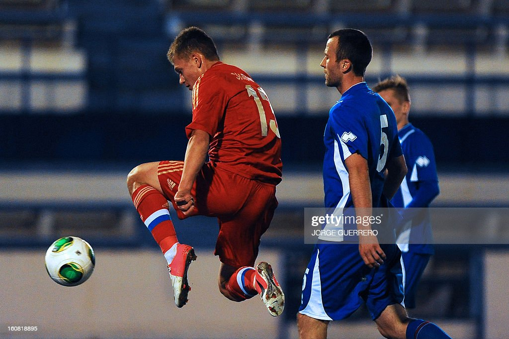 Russia's midfielder Oleg Shatov (L) celebrates after scoring during the international friendly football match Iceland vs Russia at the municipal stadium in Marbella on February 6, 2013.
