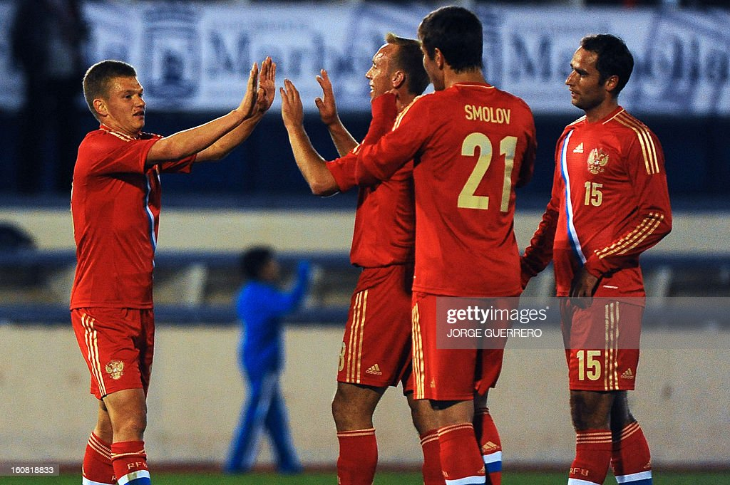 Russia's midfielder Oleg Shatov (L) celebrates with his teammates after scoring during the international friendly football match Iceland vs Russia at the municipal stadium in Marbella on February 6, 2013.