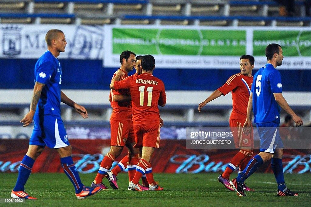Russia's midfielder Roman Shirokov (2nd L) celebrates with his teammates after scoring during the international friendly football match Iceland vs Russia at the municipal stadium in Marbella on February 6, 2013.