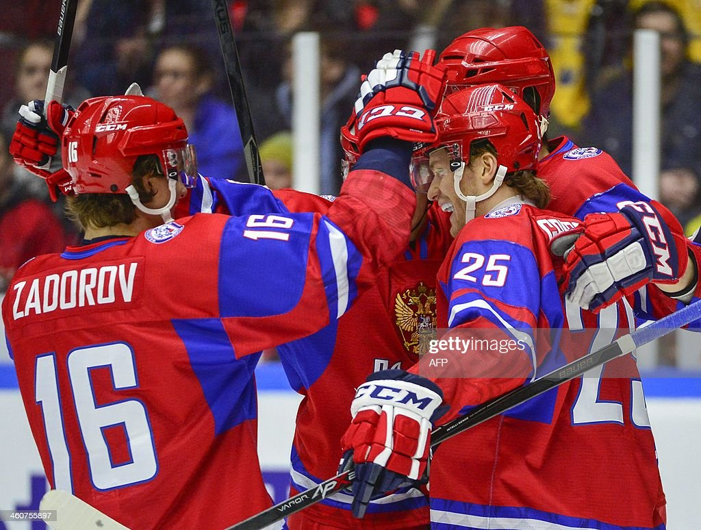 Russia's Mikhail Grigorenko (R) and his teammates celebrate the opening goal during the World Junior Hockey Championships bronze medal match between Canada and Russia at Malmo Arena in Malmo, Sweden on January 5, 2014.