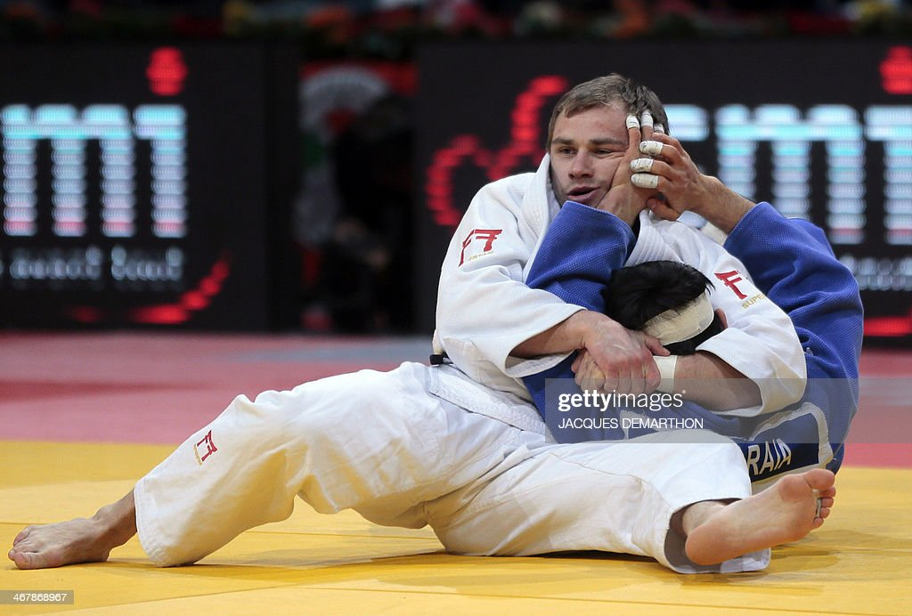 Russia's Mikhail Pulyaev competes against Ukraine's Georgii Zantaraia during the under 66kg finals at the2014 Paris Judo Grand Slam tournament on...