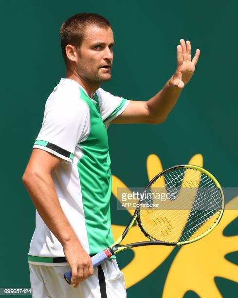 Russia's Mikhail Youzhny reacts during his match against his compatriot Andrey Rublev at the Gerry Weber Open tennis tournament in Halle western...