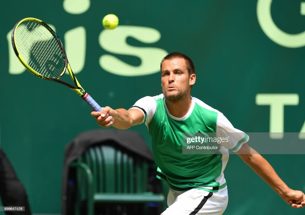 Russia's Mikhail Youzhny returns a ball to his compatriot Andrey Rublev (not in picture) during their match of the Gerry Weber Open tennis tournament in Halle, western Germany, on June 22, 2017. /