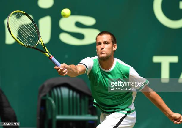 Russia's Mikhail Youzhny returns a ball to his compatriot Andrey Rublev during their match of the Gerry Weber Open tennis tournament in Halle western...
