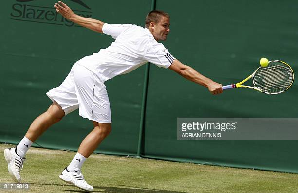 Russia's Mikhail Youzhny returns the ball to his Italian opponent Stefano Galvani during their 2008 Wimbledon championships tennis match at The All...