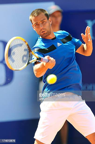 Russia's Mikhail Youzhny returns to Dutch Robin Haase at the Swiss ATP tennis open on July 28 2013 in Gstaad  Youzhny won by 6/3 6/4 AFP PHOTO /...