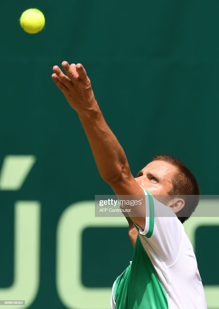 Russia's Mikhail Youzhny serves a ball to his compatriot Andrey Rublev (not in picture) during their match of the Gerry Weber Open tennis tournament in Halle, western Germany, on June 22, 2017. /