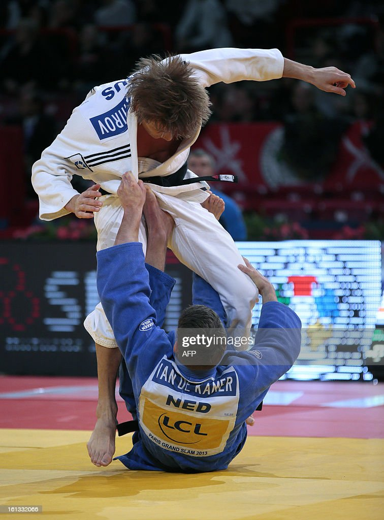 Russia's Murat Khabachirov (white) fights against Netherland's Neal Kamer (blue) on February 10, 2013 in Paris, during the eliminatories of the Men - 81kg of the Paris Judo Grand Slam tournament.