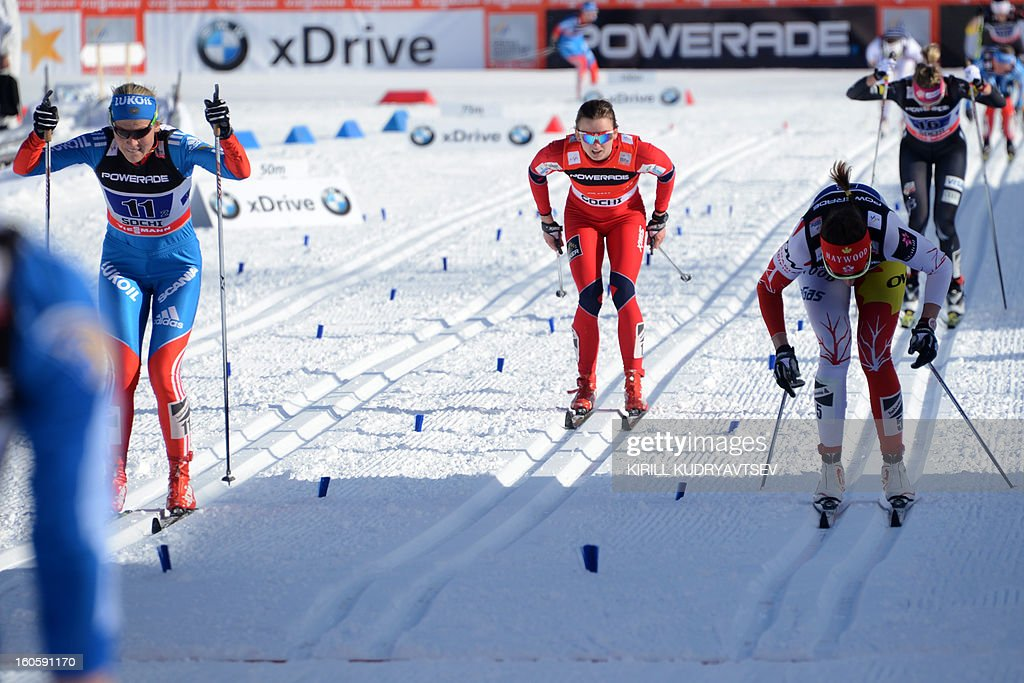 Russia's Natalia Matveeva (L) and Canada's Daria Gaiazova (R) compete during 6 x 1,25 km Ladies' Classic Team Sprint of FIS Cross Country skiing World Cup at Laura Cross Country and Biathlon Center in Russian Black Sea resort of Sochi on February 3, 2013. Finland's Mona-Lisa Malvalehto and Anne Kylloenen took the first place ahead of Russia's Julia Ivanova and Natalia Matveeva and Canada's Perianne Jones and Daria Gaiazova.