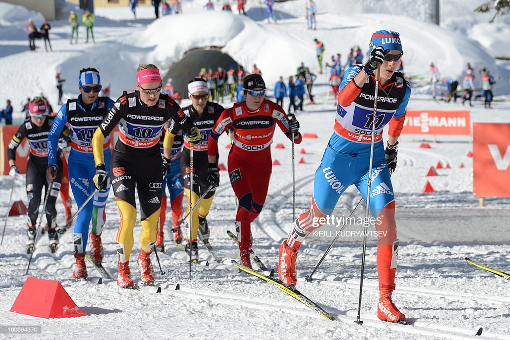 Russia's Natalia Matveeva (R) competes during 6 x 1,25 km Ladies' Classic Team Sprint of FIS Cross Country skiing World Cup at Laura Cross Country and Biathlon Center in Russian Black Sea resort of Sochi on February 3, 2013. Finland's Mona-Lisa Malvalehto and Anne Kylloenen took the first place ahead of Russia's Julia Ivanova and Natalia Matveeva and Canada's Perianne Jones and Daria Gaiazova. AFP PHOTO/KIRILL KUDRYAVTSEV