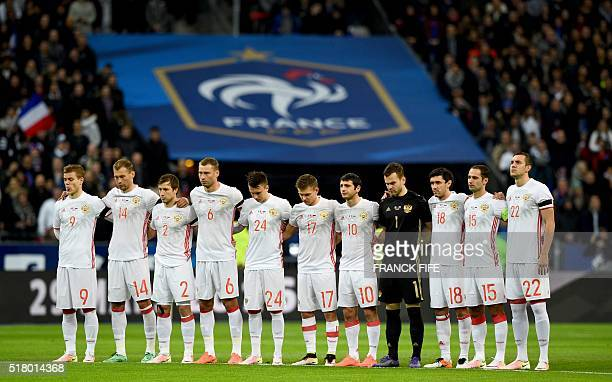 Russia's national football team observes a minute's silence for the victims of the Brussels terror attacks ahead of the international friendly...