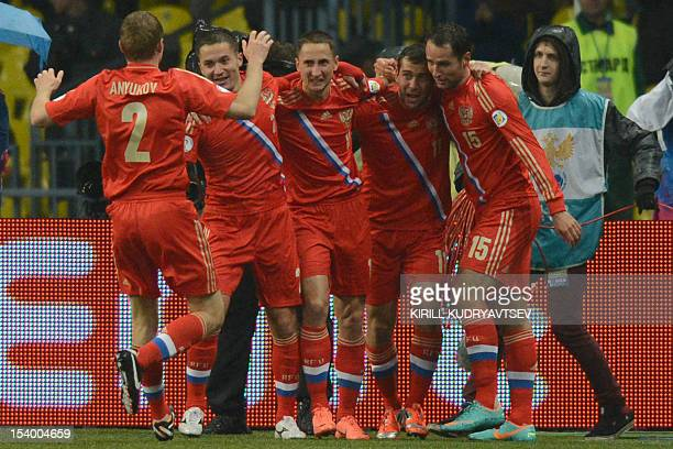 Russia's national football team players Aleksandr Anyukov Viktor Fayzulin Vladimir Bystrov Aleksandr Kerzhakov and Roman Shirokov celebrate after...