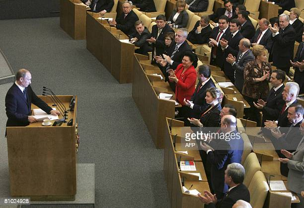 Russia's new Prime Minister Vladimir Putin is applauded by members of the State Duma in Moscow on May 8 2008 Putin was confirmed as prime minister by...