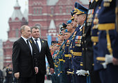 Russia's newlyinaugurated President Vladimir Putin and Defence Minister Anatoly Serdyukov speak with army officers during Victory Day parade at the...