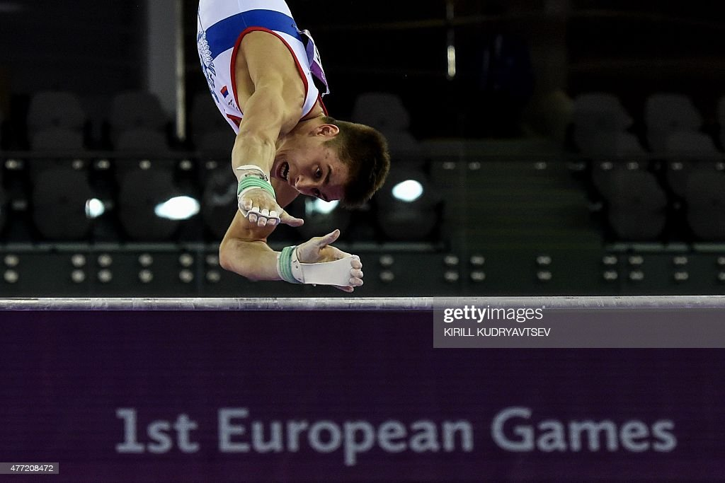 Russia's Nikita Ignatyev competes at the horizontal bar during the men's team final of the artistic gymnastics event at the 2015 European Games in...