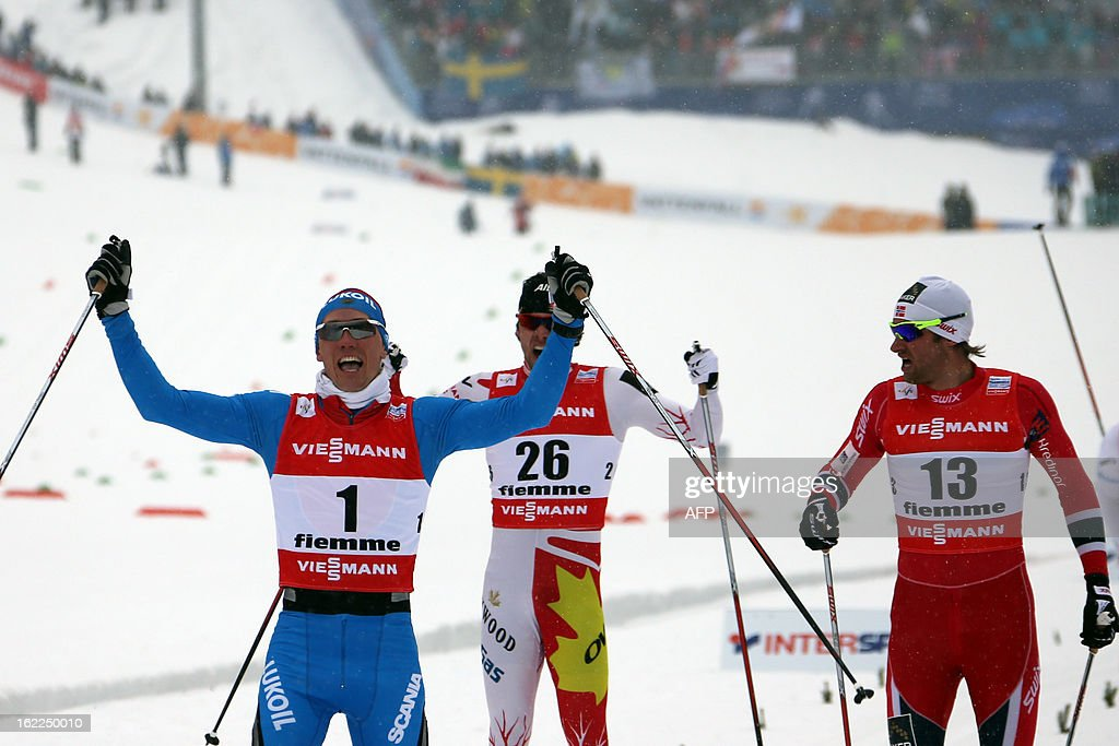 Russia's Nikita Kriukov (L) celebrates on Febraury 21, 2013 as he crosses the finish line ahead of Canada's Alex Harvey (C) and Norway's Petter Northug of the Men's Cross Country 1.5km sprint final race of the FIS Nordic World Ski Championships at Val Di Fiemme Cross Country stadium in Cavalese, northern Italy.