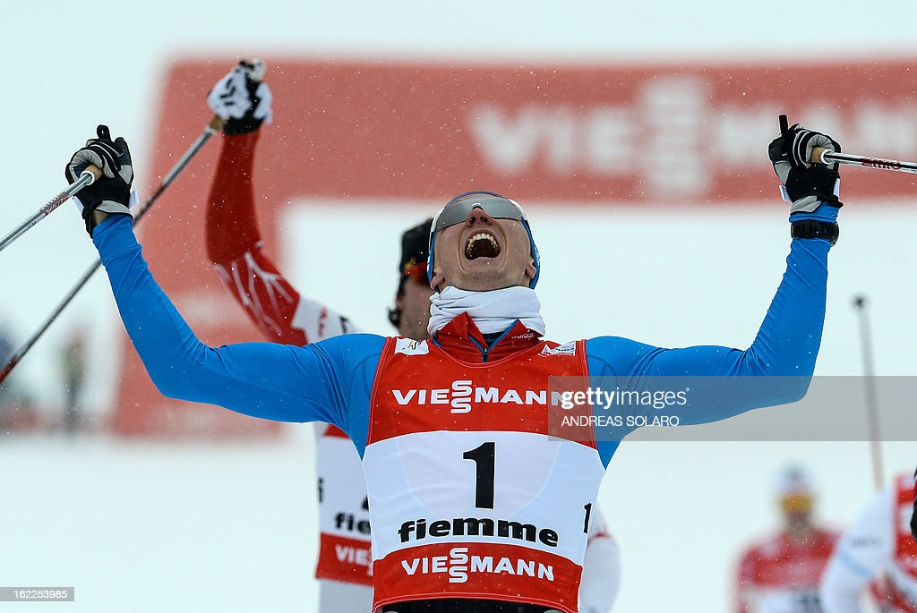 Russia's Nikita Kriukov celebrates on Febraury 21, 2013 as he crosses the finish line first at the Men's Cross Country 1.5km sprint final race of the FIS Nordic World Ski Championships at Val Di Fiemme Cross Country stadium in Cavalese, northern Italy .