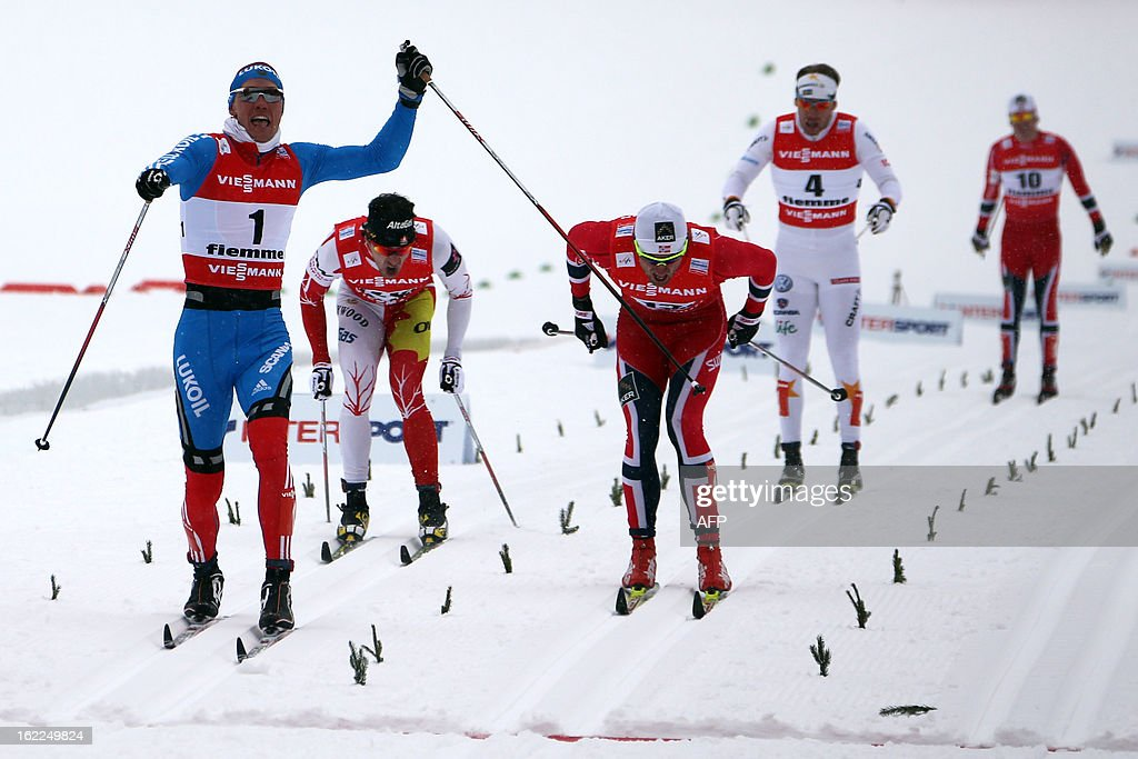 Russia's Nikita Kriukov (L) celebrates on February 21, 2013 as he crosses the finish line ahead of Canada's Alex Harvey (2ndL), Norway's Petter Northug (C), Sweden's Emil Joensson (2ndR) and Norway's Paal Golberg of the Men's Cross Country 1.5km sprint final race of the FIS Nordic World Ski Championships at Val Di Fiemme Cross Country stadium in Cavalese, northern Italy. AFP PHOTO / PIERRE TEYSSOT