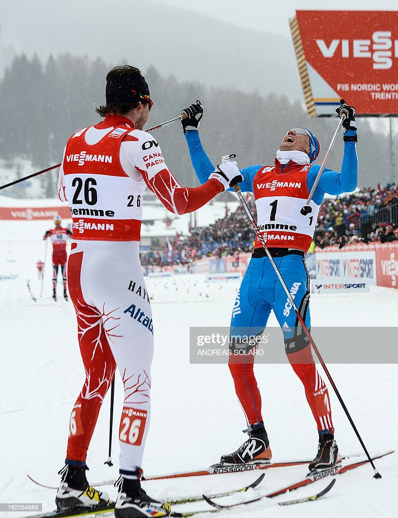 Russia's Nikita Kriukov (R) celebrates on February 21, 2013 as he crosses the finish line ahead of Canada's Alex Harvey and Norway's Petter Northug (unseen) of the Men's Cross Country 1.5km sprint final race of the FIS Nordic World Ski Championships at Val Di Fiemme Cross Country stadium in Cavalese, northern Italy. AFP PHOTO / ANDREAS SOLARO