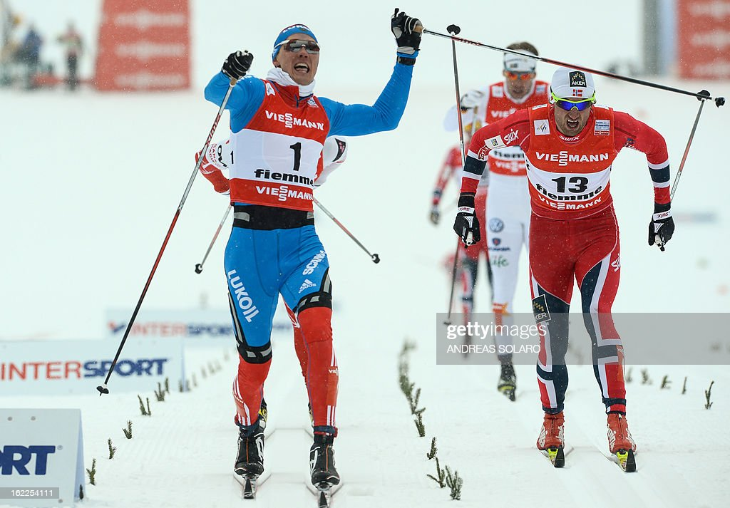 Russia's Nikita Kriukov (L) gestures on Febraury 21, 2013 as he crosses the finish line ahead of Norway's Petter Northug (R) at the Men's Cross Country 1.5km sprint final race of the FIS Nordic World Ski Championships at Val Di Fiemme Cross Country stadium in Cavalese, northern Italy.