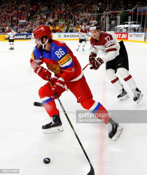 Russia's Nikita Kucherov and Latvia's Oskars Cibulskis vie during the IIHF Ice Hockey World Championships first round match between Russia and Latvia...