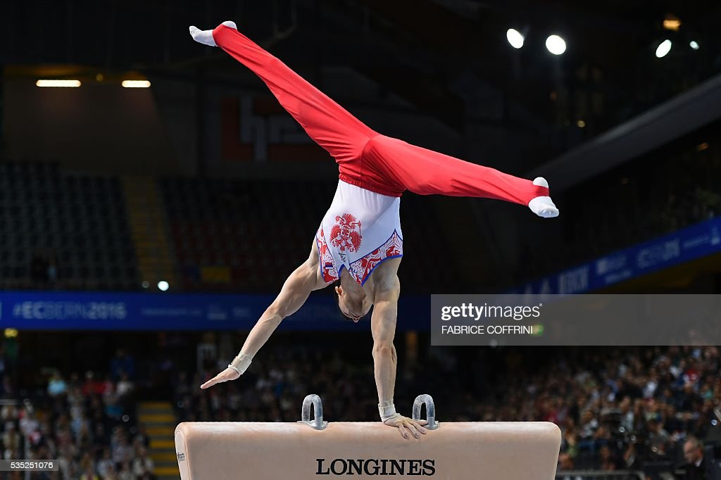 Russias Nikolai Kuksenkov performs during the Mens Pommel Horse competition of the European Artistic Gymnastics Championships 2016 in Bern, Switzerland on May 29, 2016. / AFP / FABRICE