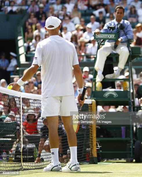 Russia's Nikolay Davydenko argues with the umpire during his match against Czech Republic's Tomas Berdych during the Wimbledon Championships 2009 at...