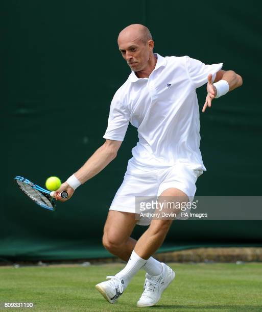 Russia's Nikolay Davydenko in action against Australia's Bernard Tomic during day two of the 2011 Wimbledon Championships at the All England Lawn...
