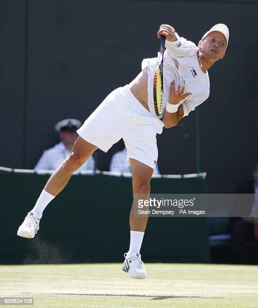 Russia's Nikolay Davydenko in action against Czech Republic's Tomas Berdych during the Wimbledon Championships 2009 at the All England Tennis Club