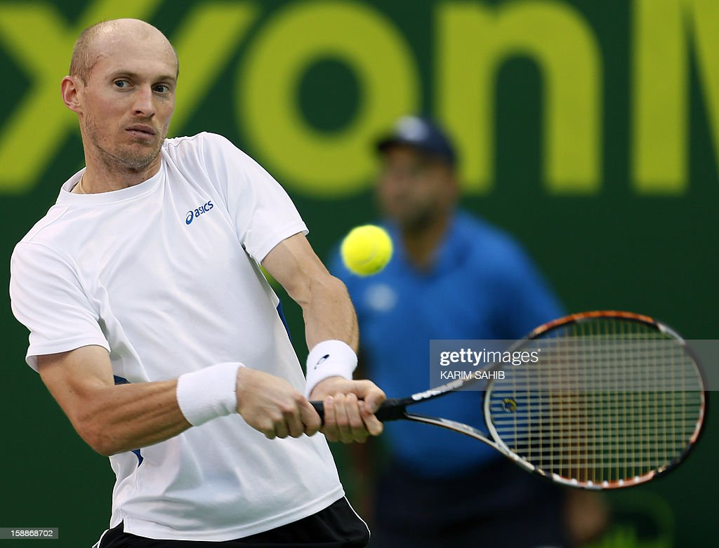 Russia's Nikolay Davydenko returns the ball to his compatriot Mikhail Youzhny during the 2013 ATP Qatar Open in Doha on January 02 2013 AFP...