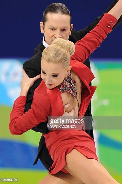 Russia's Oksana Domnina and Maxim Shabalin perform in the figure skating Ice Dance compulsory dance 'Tango Romantica' t the Pacific Coliseum in...