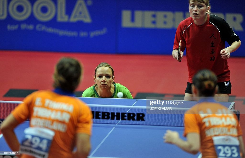 Russia's Oksana Fadeeva and Lithuania's Ruta Paskauskie (center top) return a ball to Holland's couple Jie Li and Elena Timina during their women's doubles final match of the European Table Tennis Championships in Ostrava on September 19, 2010.