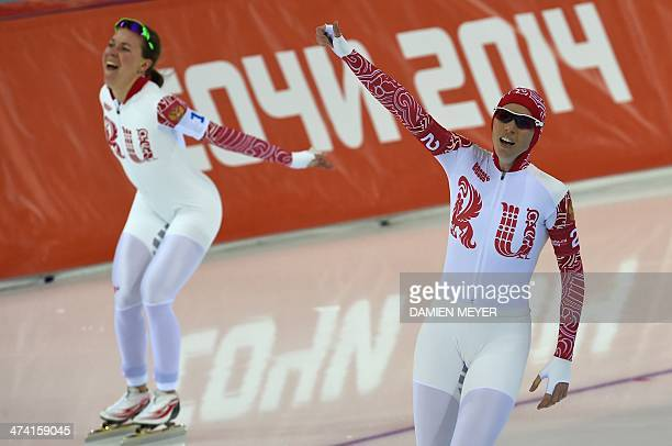 Russia's Olga Graf and Russia's Ekaterina Lobysheva celebrate after the Women's Speed Skating Team Pursuit Final at the Adler Arena during the Sochi...
